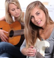 girls playing guitar to stay motivated - motivation